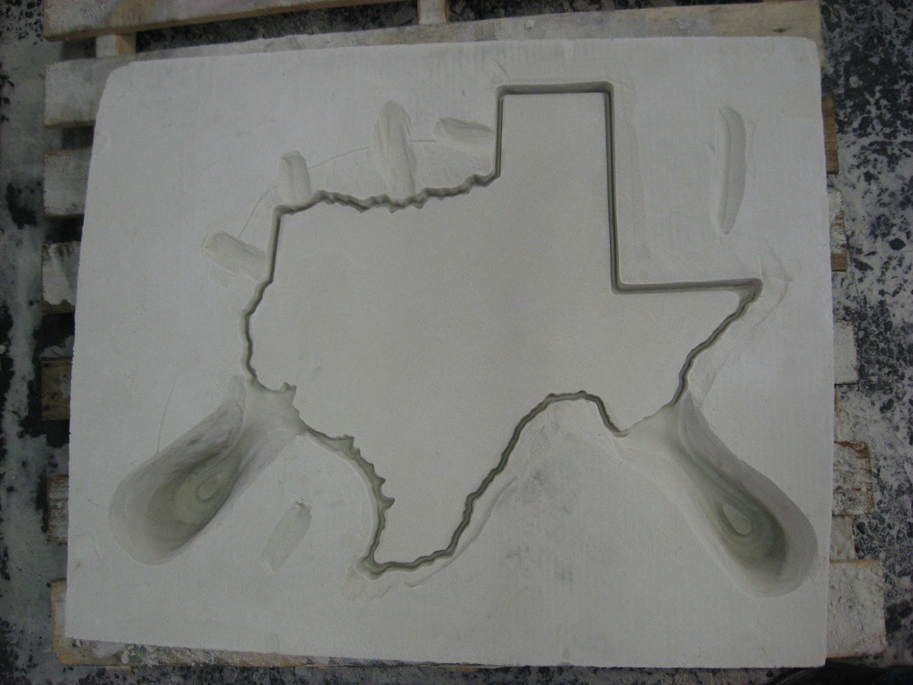 Texas drag with the gating cut into it, ready for mould wash.