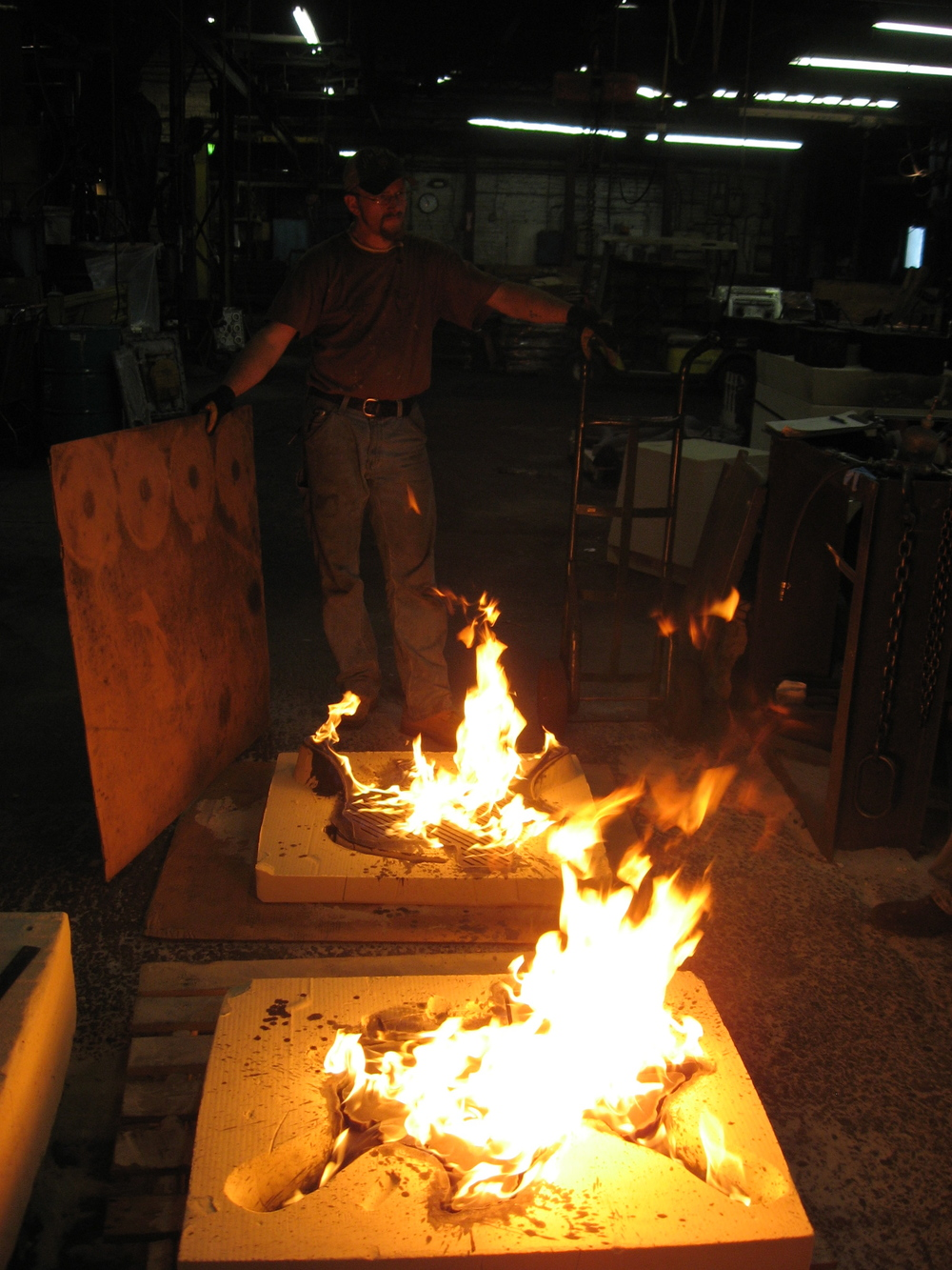 Kelly made a fire wall around the large Texas wall, so that none of these flames could get too out of control inside the foundry.