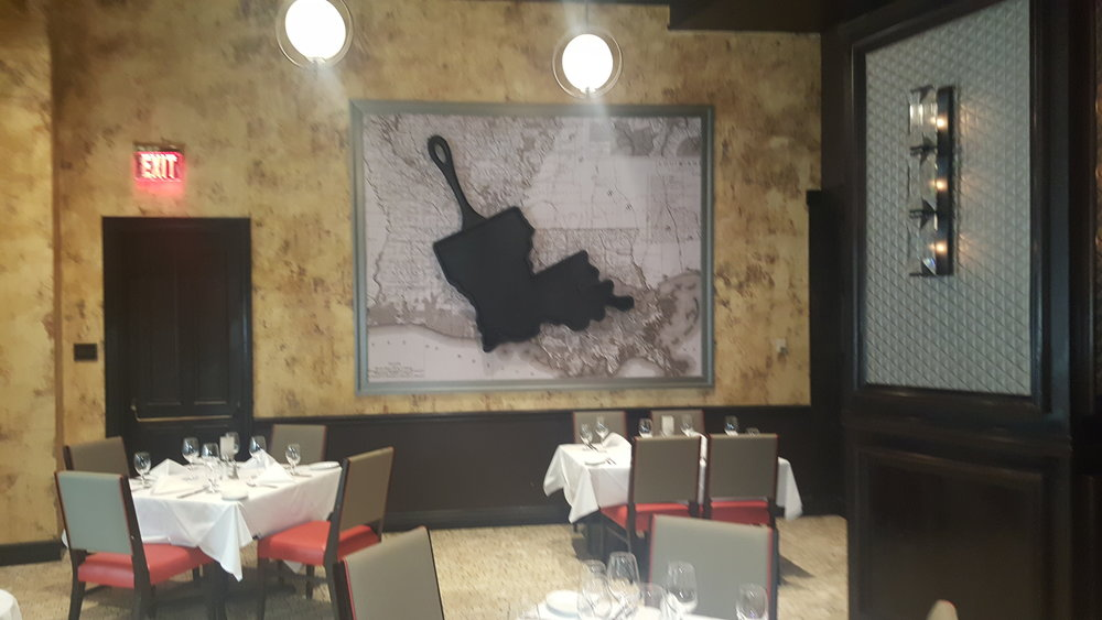"""Louisiana Skillet"" (2016)  Ruth's Chris Steakhouse, New Orleans, LA, (inside Harrah's Hotel.). Commissioned art piece for the dining room, this over sized Louisiana skillet measures 5ft x 5ft, made of composite material and styled like cast iron."