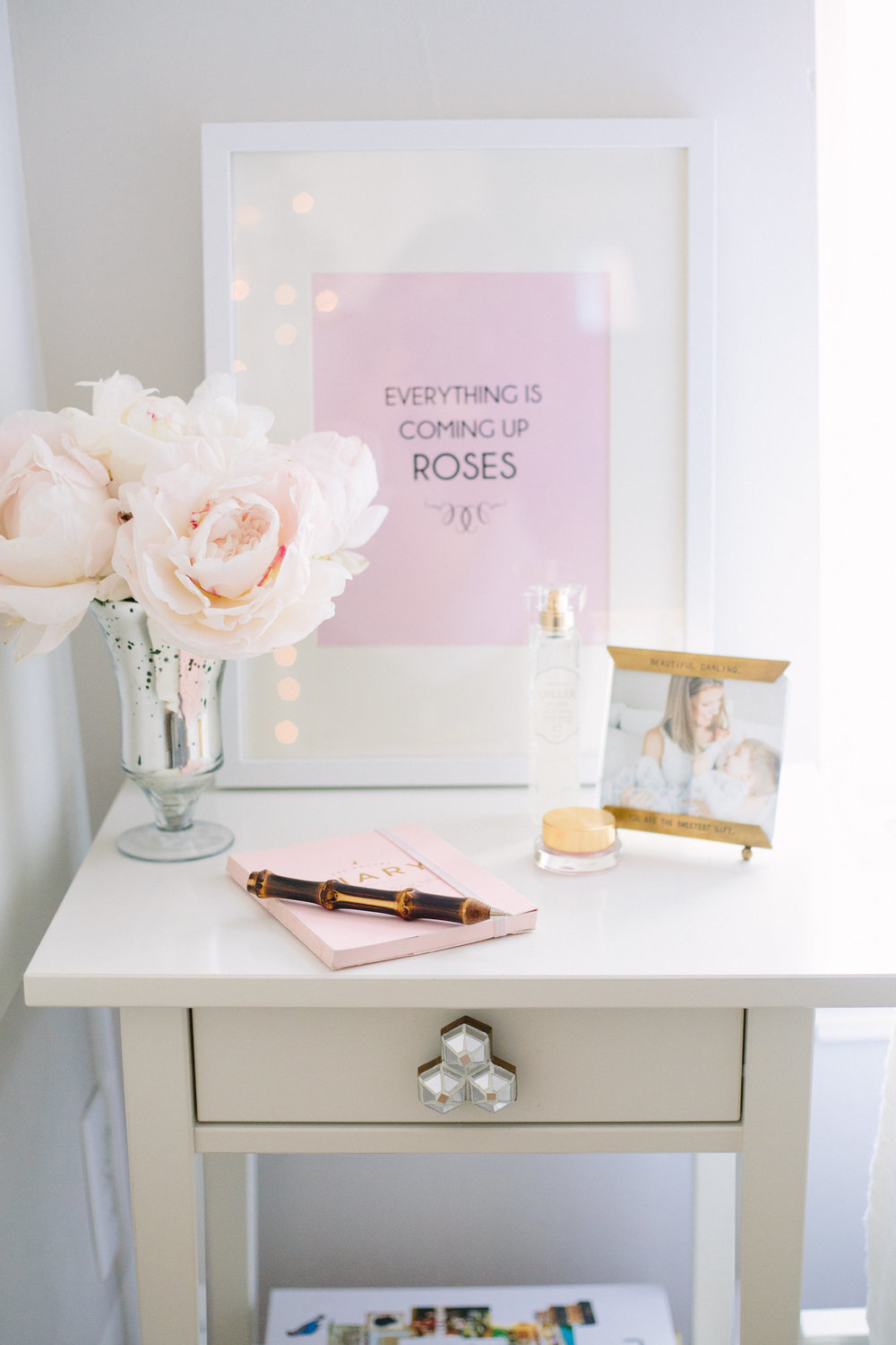 Small easel photo frame and bamboo pen fromHUDSONin the South End—sweet additions to any mommy's nightstand. Journal from Mara-Mi, Lollia At Last and Albeit Rose lip gloss fromAnthropology.