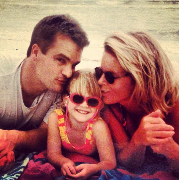 Is this not the cutest throwback? Paige on the beach with her parents!