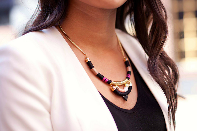 Fashion blogger, Laura Saur of LoSo Fancy modeling a Coral & Stone piece. Photo by Allison Sepaneck.