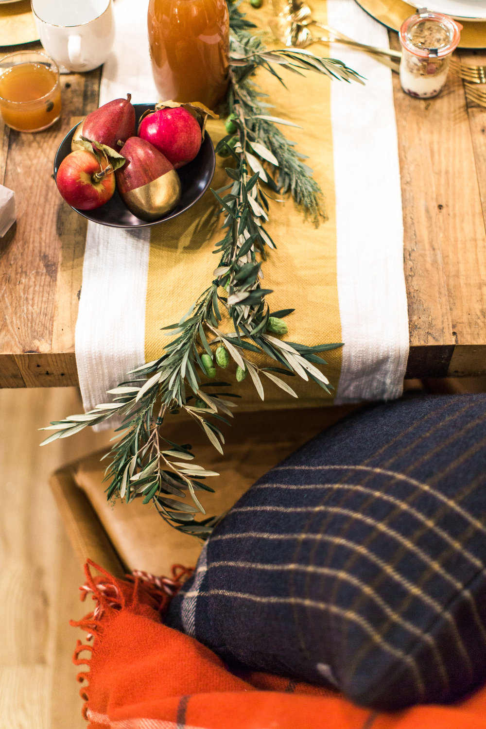 This simple olive branch and mixed greenery runner is simple, easy to do, and adds life to any table.