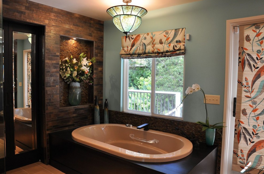 Master Bedroom Retreat and Spa  Master drop-in tub and overhanging pendant.