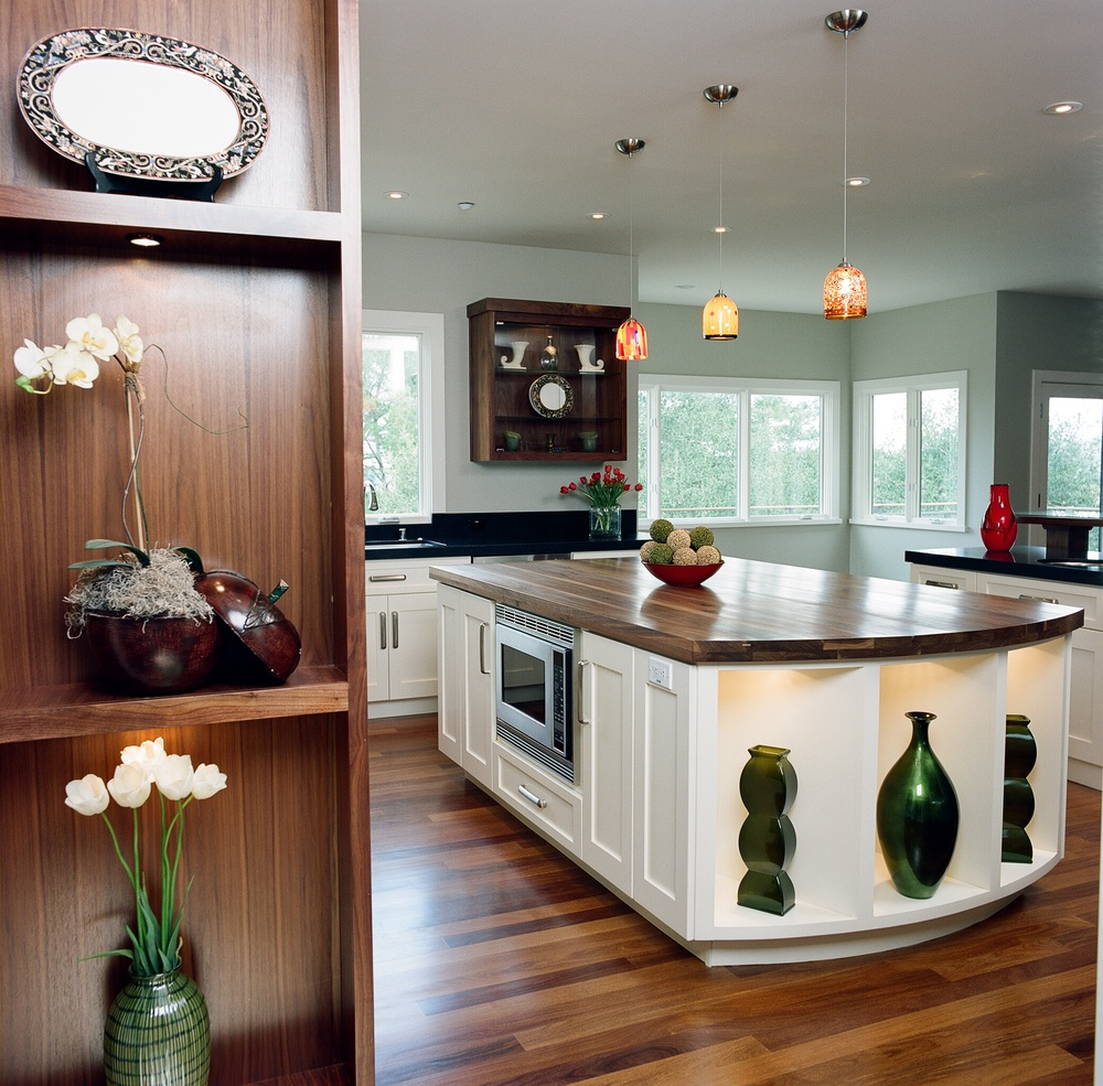 Wood floor and large island top kitchen