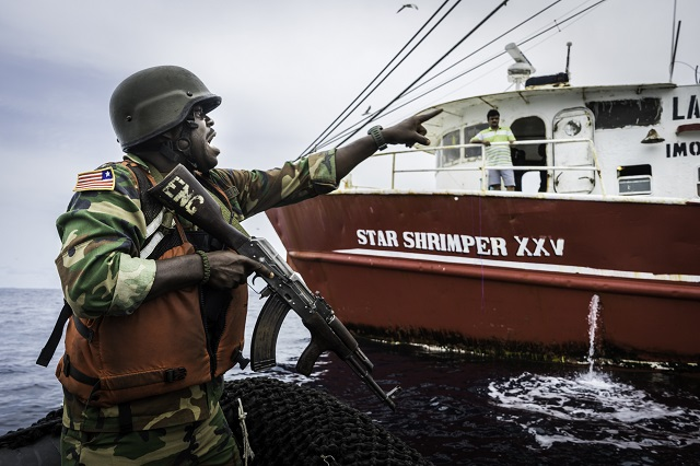 "The man with the gun seems to be the real ""friend of the sea""...  (Image by Sea Shepherd"