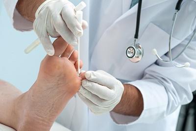 Doctor examining a foot.