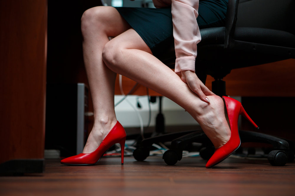 Woman with high heels with heel pain