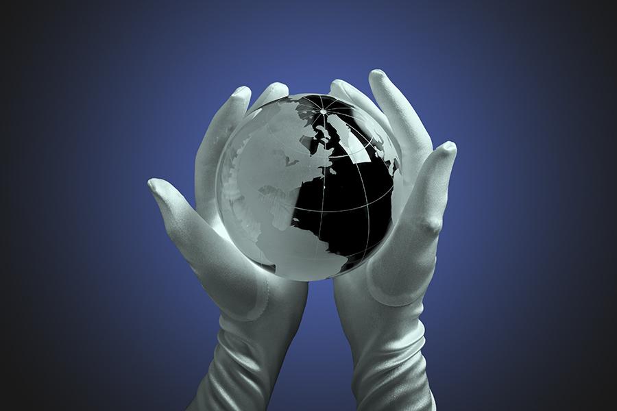 I@Glass globe in hand with light.jpg