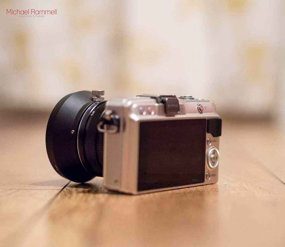 "Olympus E-PM2 ""Pen Mini"" - That pesky video record button just underneath the shutter button."