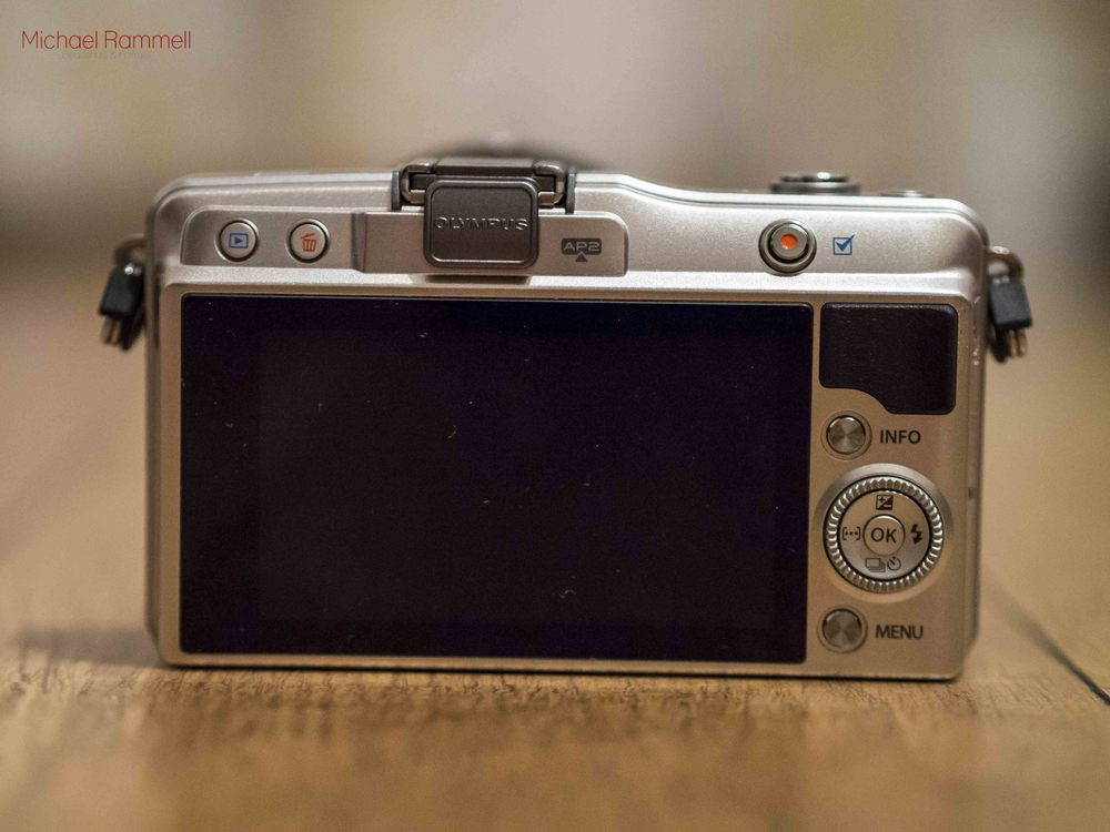 Olympus E-PM2  - The rear of the camera showing the 3 inch touch screen display and controls