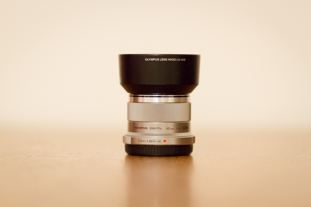 The Olympus M.Zuiko 45mm f/1.8 with the LH-40B Lens Hood