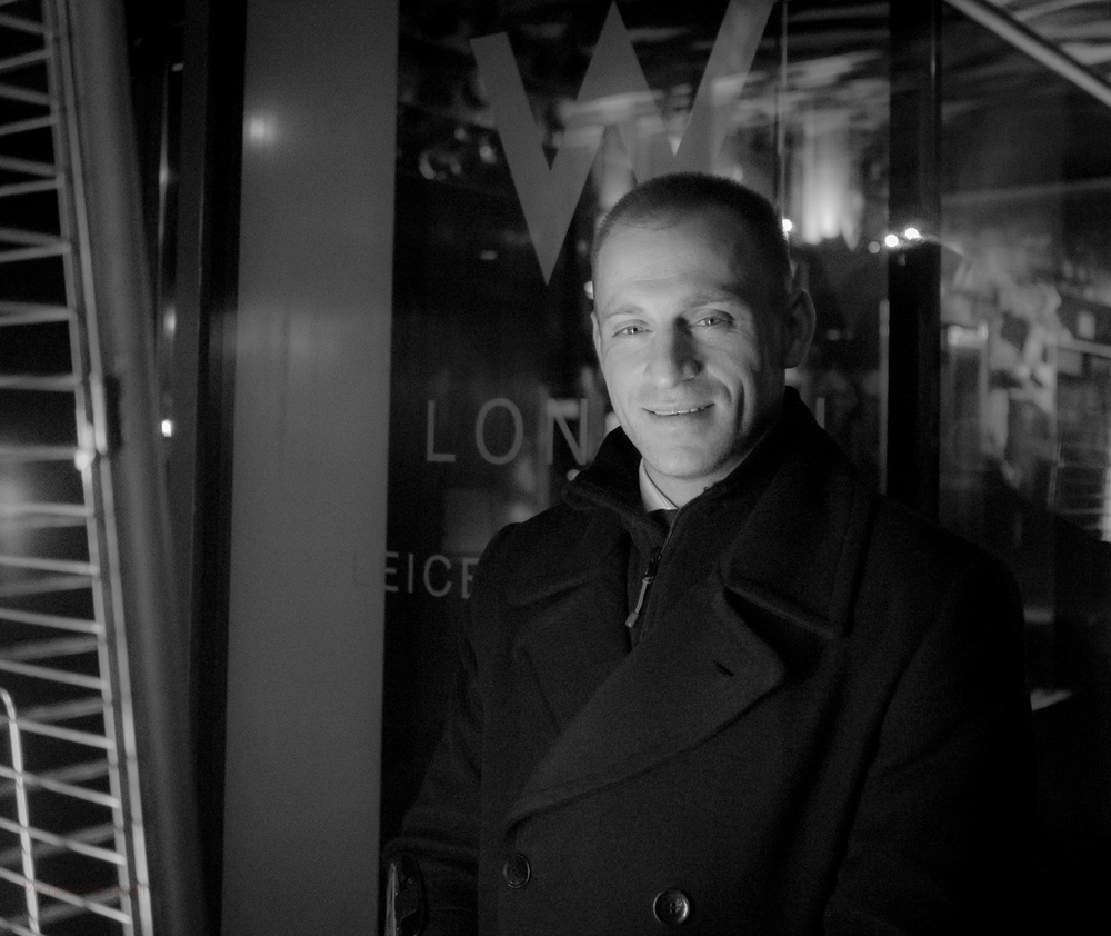 A doorman outside a Leicester Square Hotel, London | Olympus OM-D E-M5 with the Olympus M.Zuiko 17mm f/1.8 @ ISO 5000