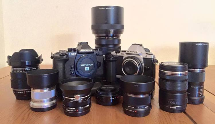 My tools and toys - The Olympus OM-D E-M5 and E-M1 surrounded by my favourite primes and pro zooms.