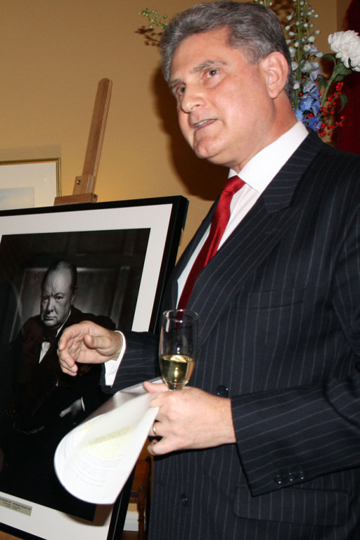 High Commissioner Dr. Andrew Pocock and the Karsh portrait.