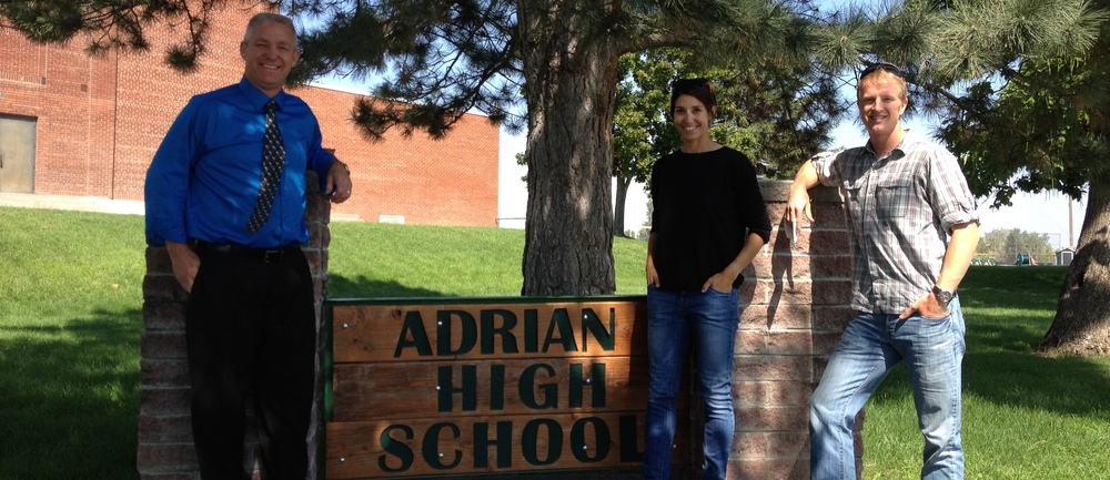 Adam and Ashley with Adrian High School Principal Purnell, July 2014