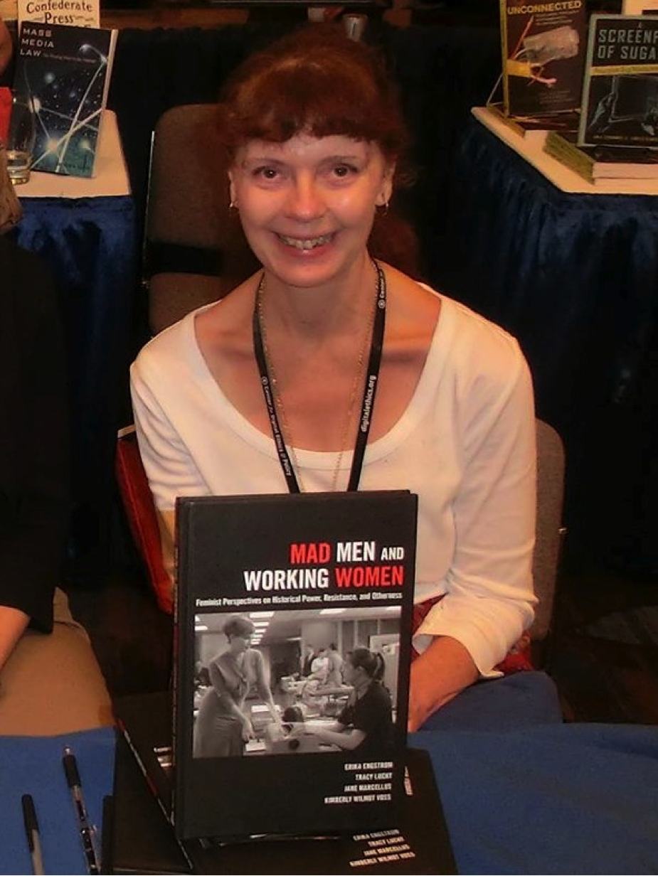 Jane is pictured here with Mad Men and Working Women: Feminist Perspectives on Historical Power, Resistance, and Otherness (Peter Lang, 2016), a book she co-authored with three other women.