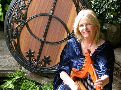 Ani Williams, harpist and sacred tour leader at Chalice Well, Glastonbury.