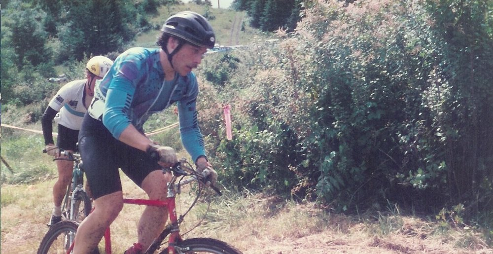 "Larry Papadopoulos, leading the way as he powers through the mountain bike race course, before it was ""a thing"".  Larry has always been ahead of the game, but most of all, passionate about riding!"