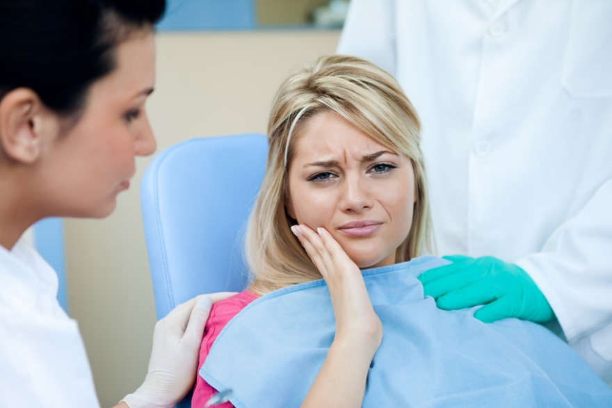 woman with toothache dental emergency