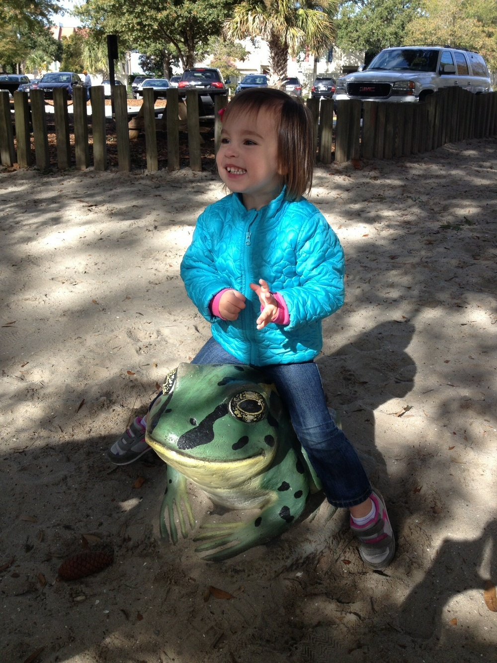 Riding the turtle at the playground in Harbor Town. No trip to Hilton Head is complete without a trip to Harbor Town.