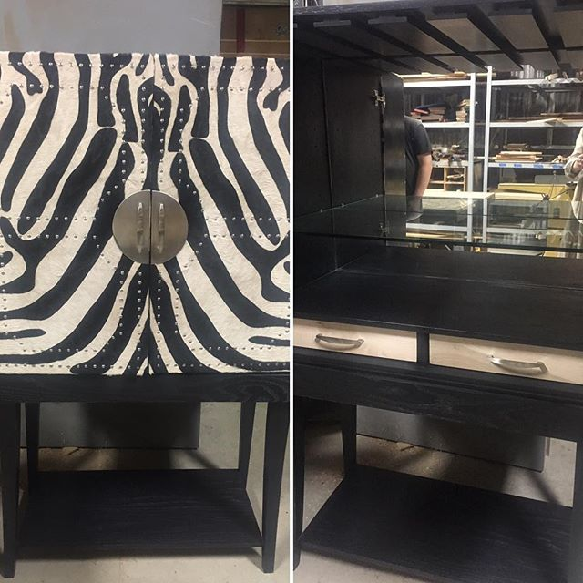 Custom made bar cabinet with cowhide and nailhead details for a special DC project!  Features inside include mirror, LED lighting, birch drawers, glass shelving, wine glass insets, truly custom.  #maryamonsdesign #interiordesign #design #custommade