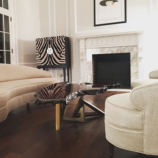 Another sneak peak of our latest project install in progress!  Original @maryamonsdesign custom coffee table, zebra hide bar cabinet, twin kidney shaped sofas.  @maryamonsdesign #customeverything #originaldesign #interiordesign #maryamonsdesign