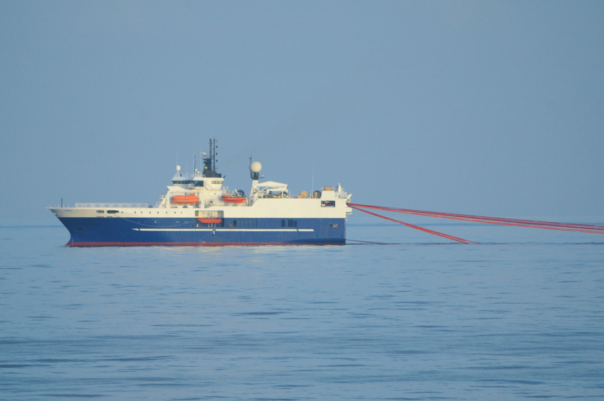 Photo of a seismic survey vessel towing hydrophone streamers.
