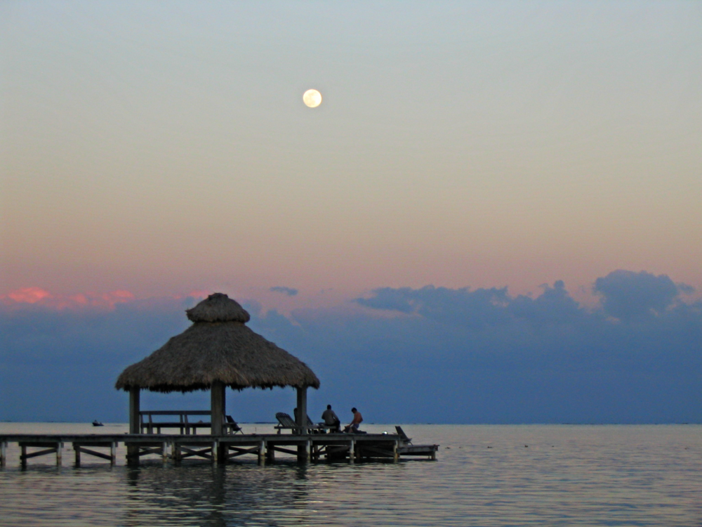 The full moon rising over Belize's barrier reef as seen from the shore of Ambergris Caye. Photo property of SabreWing Ltd.