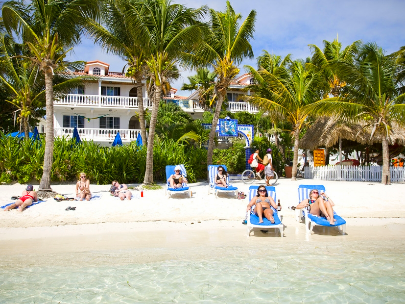 Guests  relax on the beach in front of the Blue Tang inn