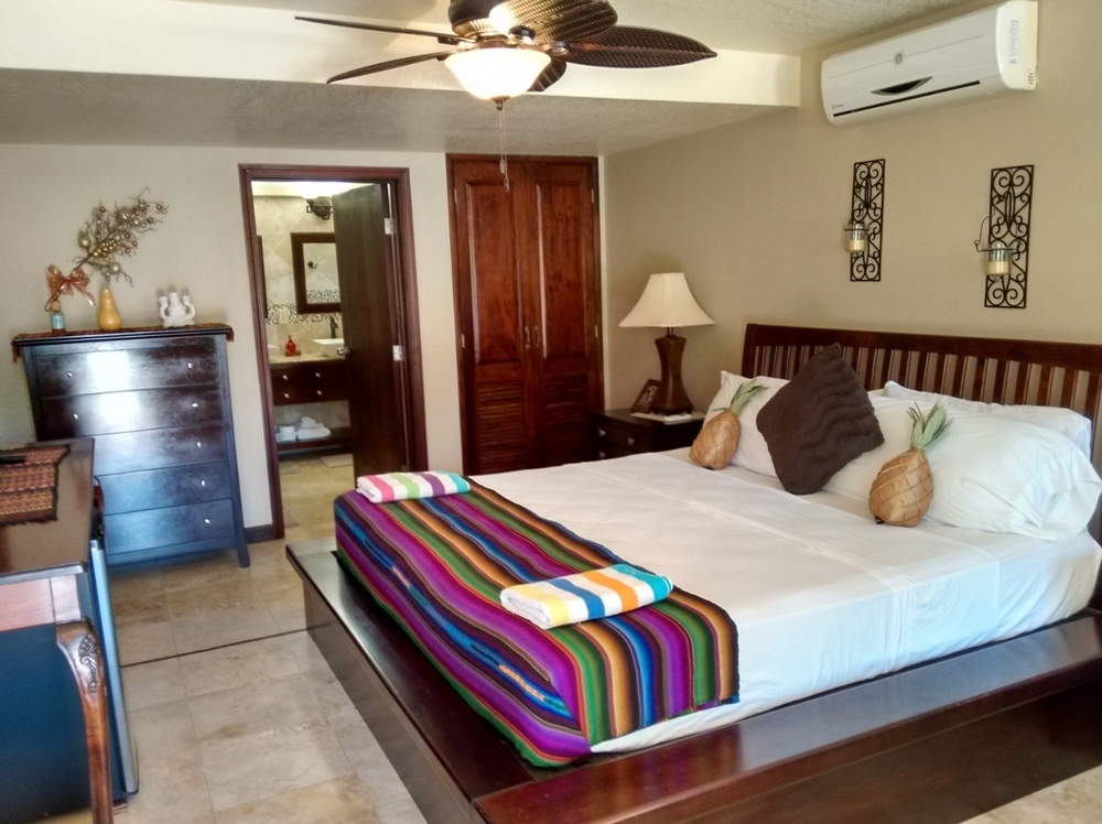 the comfortable king rooms at Caribbean Shores B&B
