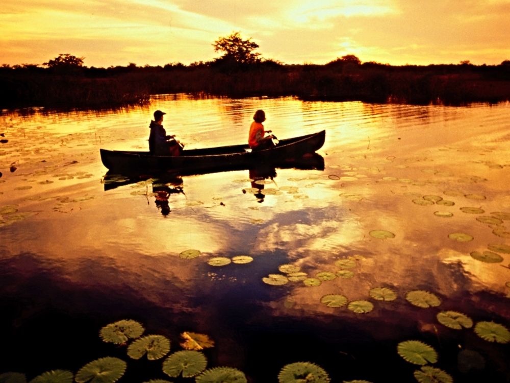 Taking in the dawn by canoe, Lamania Outpost Lodge