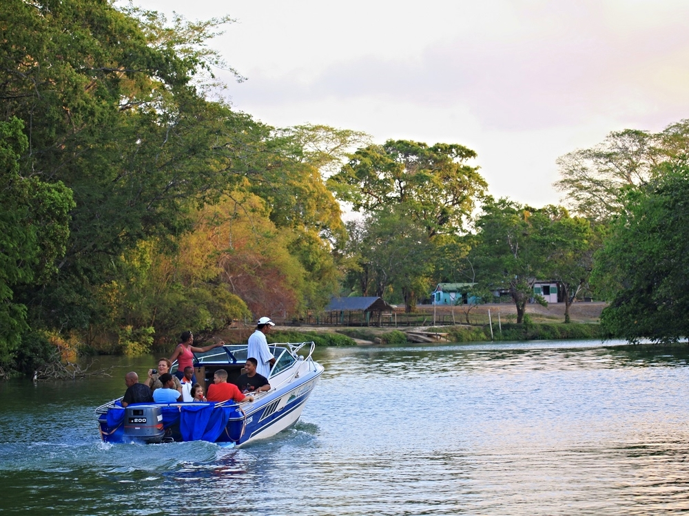 Taking a boat ride on the Old Belize River