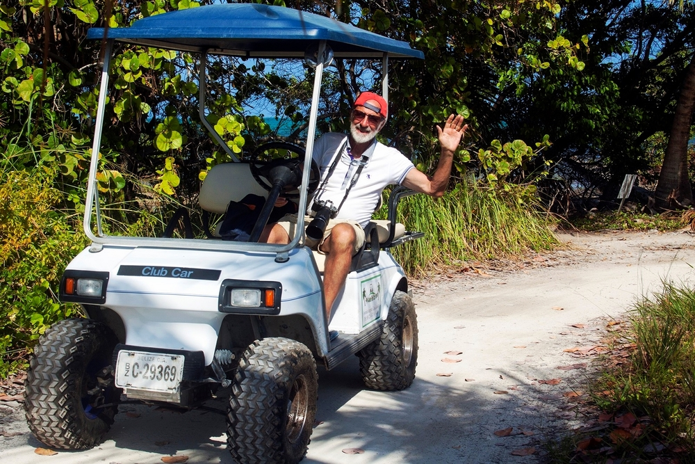 Renting a golf cart is a fun way to explore islands like Caye Caulker and Ambergris Caye