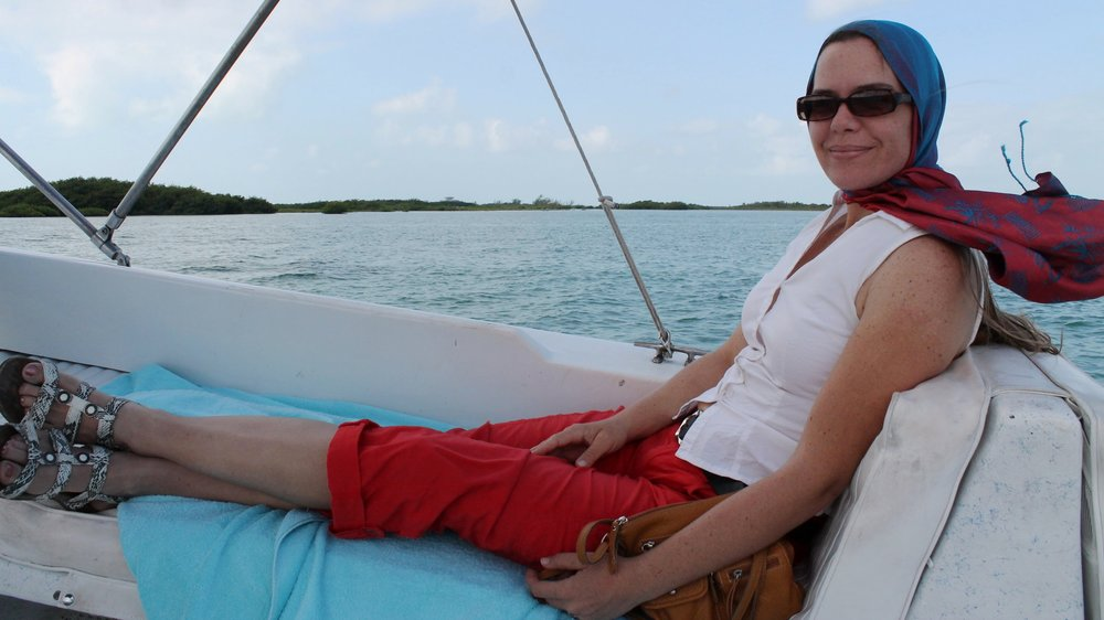 Catarina taking in the breeze on a visit to Cayo espanto, one of our partner resorts near san pedro ambergris Caye