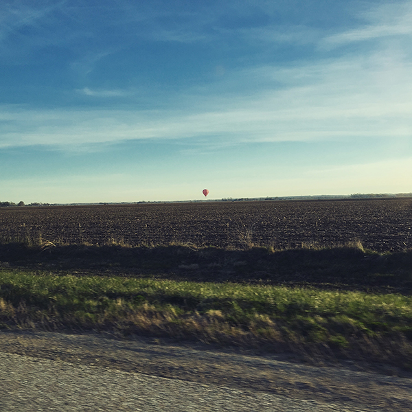 APRIL 9th: Katie drives to Schuyler, Justin takes a photo of a balloon.