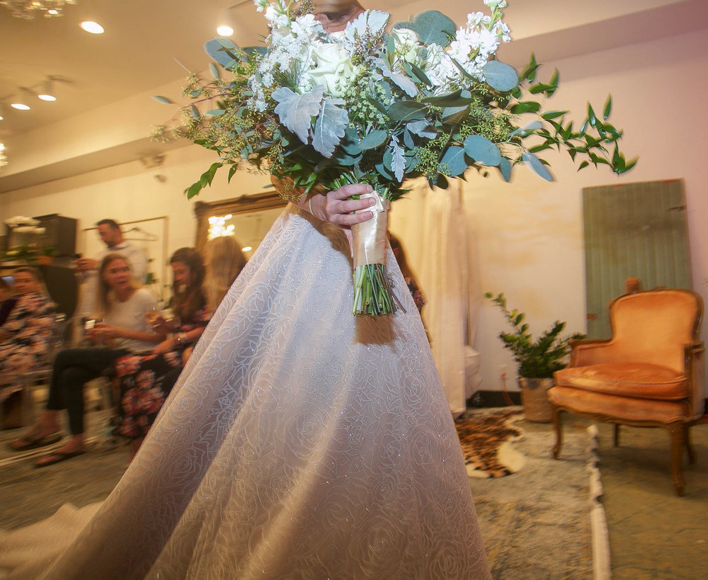 Melinda Hoffman, Owner & Floral Designer of Flowers By Melinda Too located in Point Pleasant NJ has morphed her magic of designing unique wedding floral designs by offering designer gowns to brides in her new bridal salon located within her flower shop.  Photography courtesy The Aisle Photography  -Bridgette Stomiany