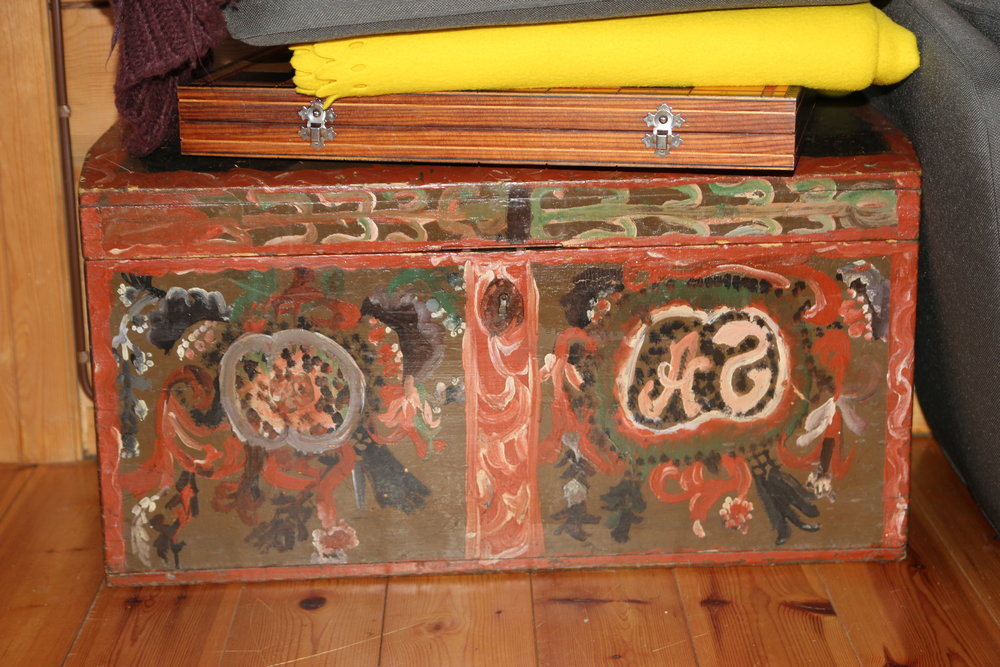 """A very old box hand built and painted by Vegard's grandparents. In Norway they call this type of handwork """"rose painting""""."""