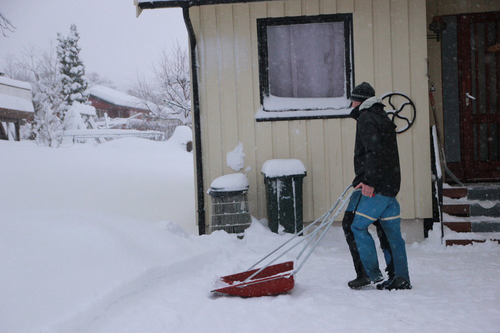 Our wonderful landlord doing the daily snow clearing.