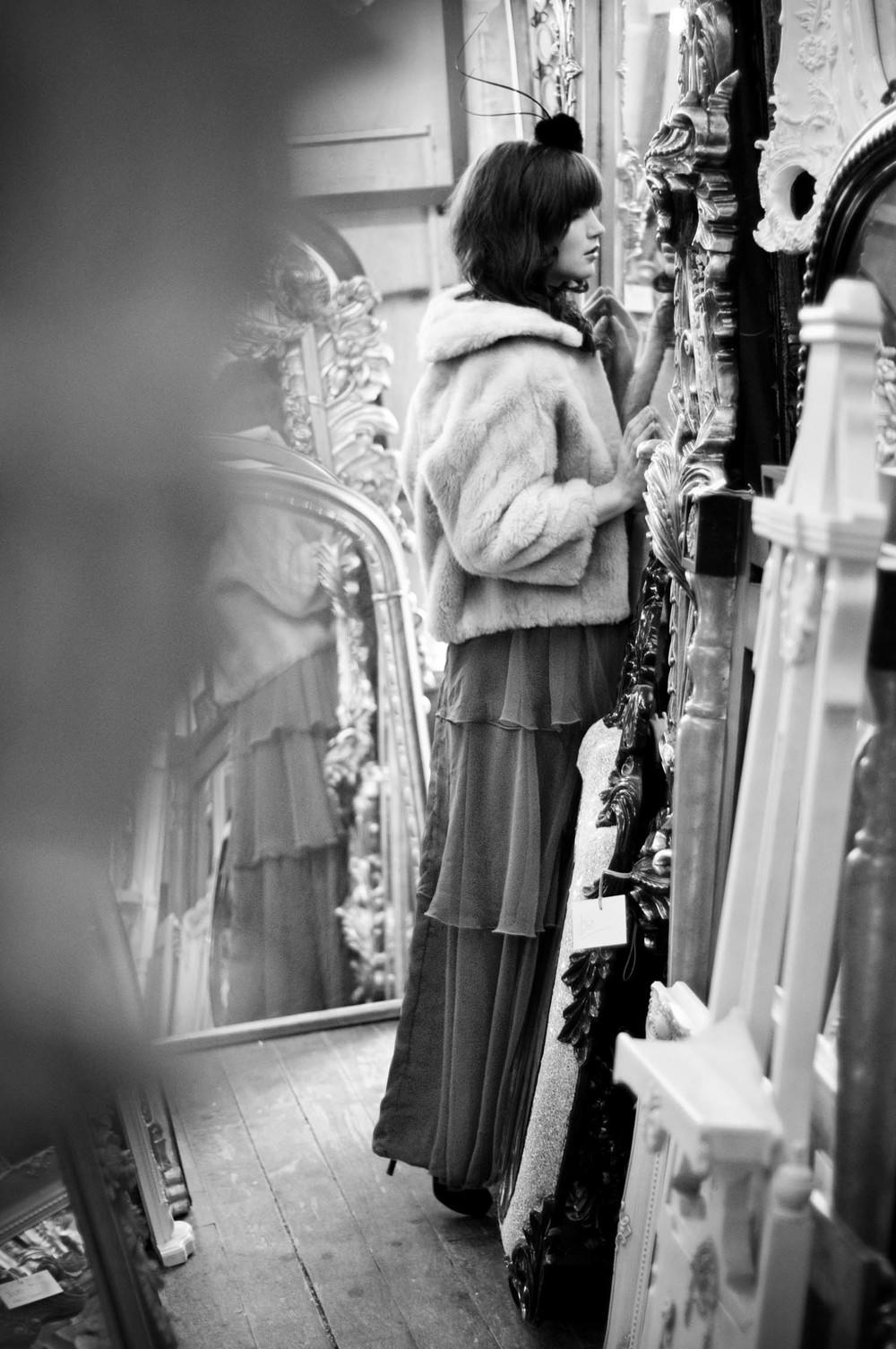 Model in Mirror Shop