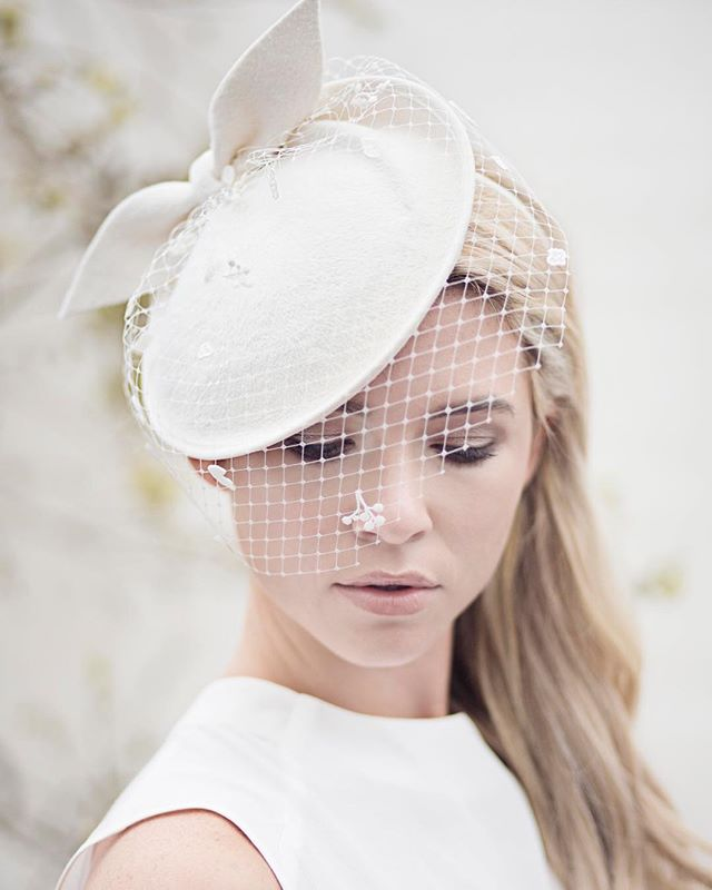 Flashback to our classic bridal hat Adele, still a design we offer our clients as it is one of our favourites and our clients seem to quite like this one too!  We love that our brides are willing to go the extra step with a hat as opposed to a traditional veil (though we love and make those too), Maggie is always available for advice if you are considering a hat and not sure which design to choose! ·· #bespoke #handmade #designer #edinburgh #millinery #boutique #bridal #accessory #wedding #weddingideas #whitehat #veil #modernveil #lovehats #lovemillinery #bridalmillinery