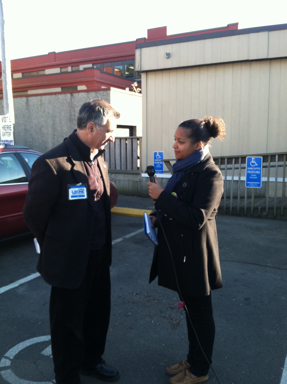 Assistant Majority Leader, State Senator Carlo Leone, pauses for an interview outside the polls (2012).