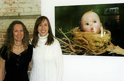 "Los Angeles County Museum of Art's (LACMA), Assistant Curator of Modern Art - Sara Cochran, Ph.D and Linda Frost next to ""Before the Fall"" from the 'Doll Dreams' series, 2007"