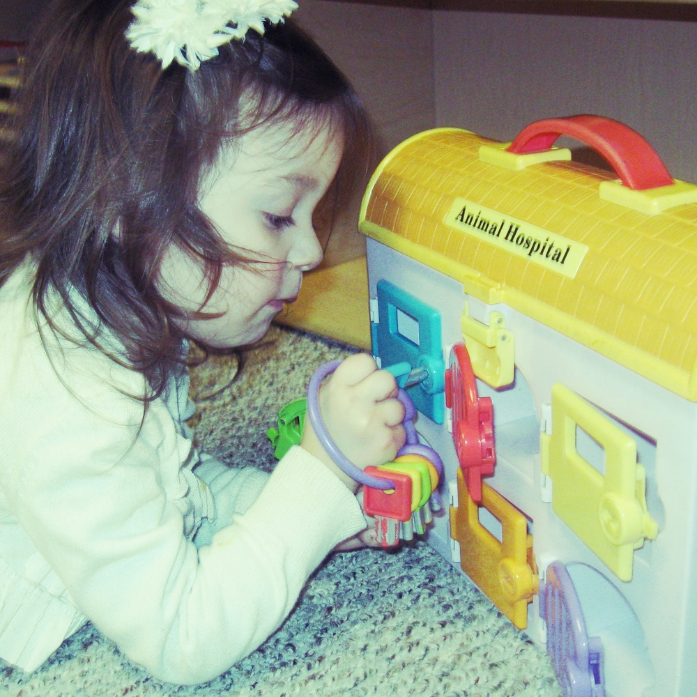 A key ring and lockbox activity provides fine motor practice along with shape and color matching--skills that are foundational for early math.