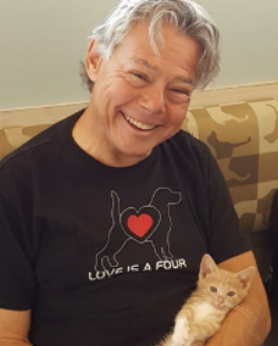 Bob Ferber with a rescue kitten Monty who was born with a leg deformity. Through rehabilitation that Bob provided, Monty now can play and run around like a normal cat.