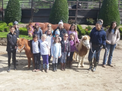"Volunteers Chanera (front right) and Kaui (back left), mini horses Chopper and Clyde, and Ambassador Thoroughbred ""I Love Lulu "" host an event at the ranch. Read Chanera's introduction to volunteers and testimonial below."