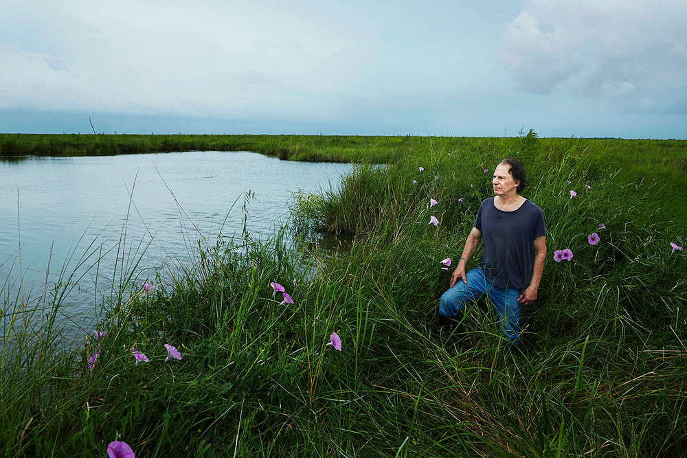 Environmental Activist Lawyer John Barry- photographed on the coastline of Louisiana.