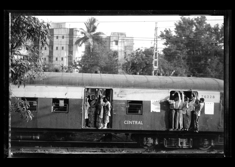 A passenger train en route from Mumbai to Pune, India