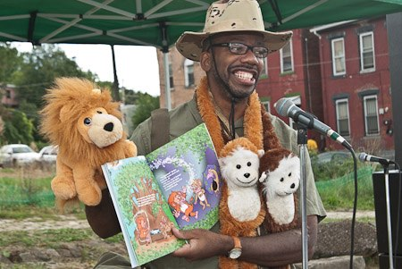 "Author Roland Barksdale-Hall reading his book ""Lion Pride"" at Ujamaa's Children's Literacy Festival in the Marketplace"