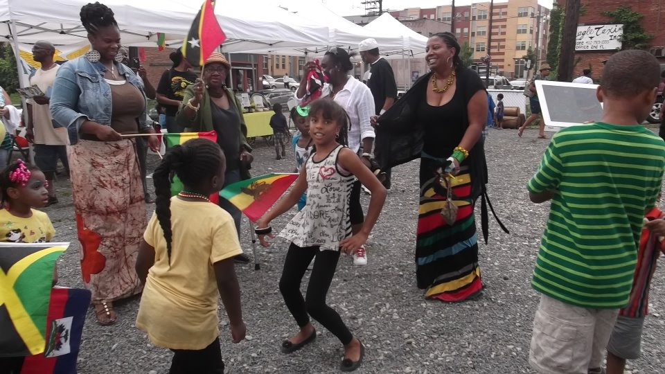 "Community celebration of culture at ""Spice the Pot"" Caribbean Carnival in the Marketplace"